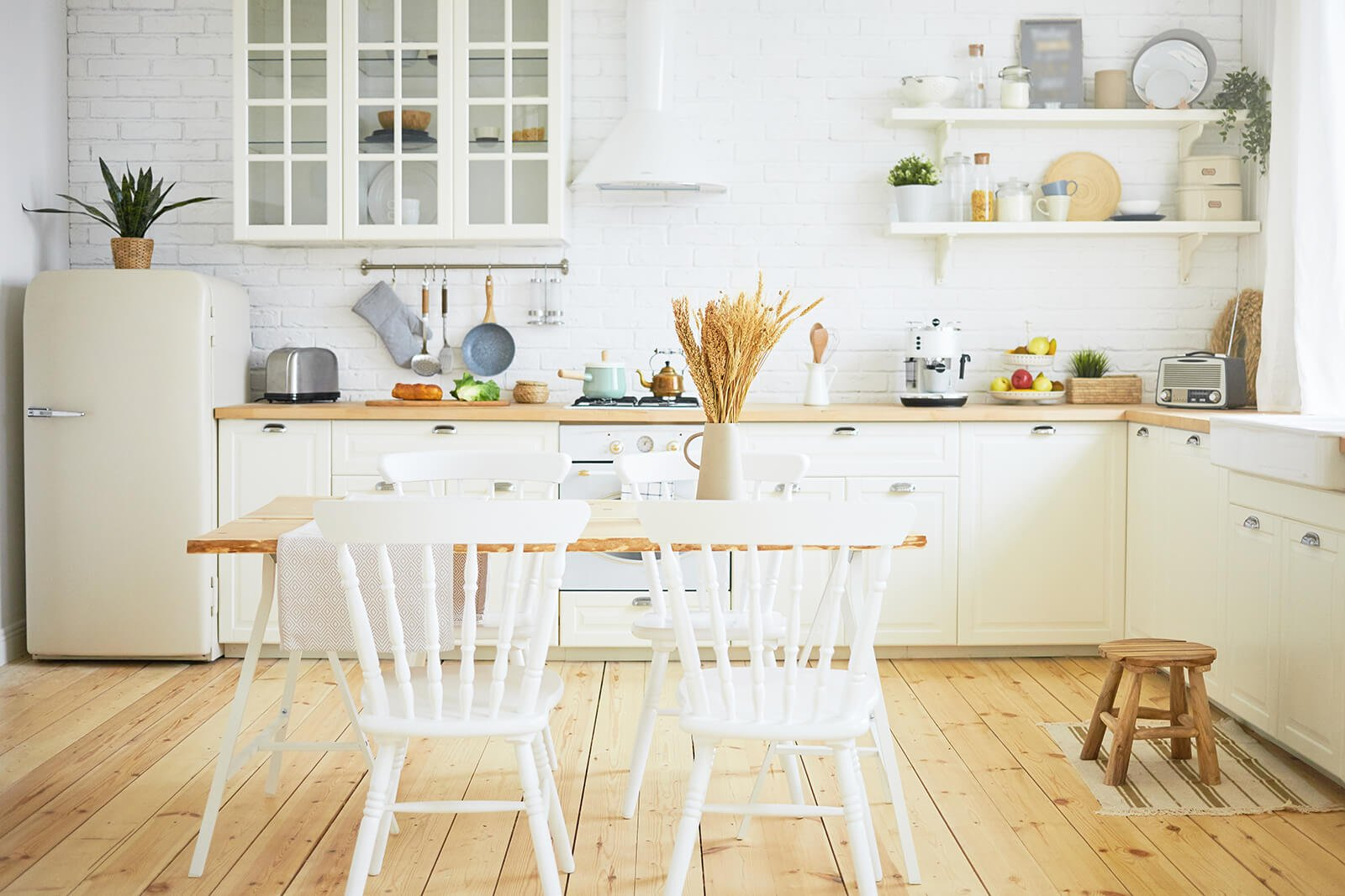 stylish-scandinavian-kitchen-interior-chairs-table-foreground-fridge-long-wooden-counter-with-machines-utensils-shelves-interiors-design-ideas-home-coziness-concept (2) (1)